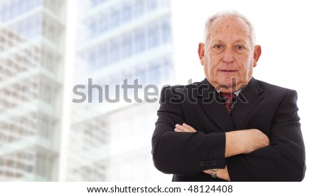 Senior businessman smiling next to his office