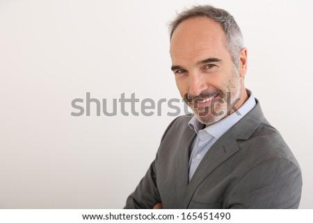 Senior businessman standing on white background - stock photo