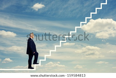 senior businessman stepping up the stairs