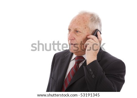 senior businessman talking on his cellular (isolated on white)