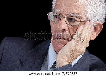 Senior businessman thinking with his hand at the chin (isolated on black) - stock photo