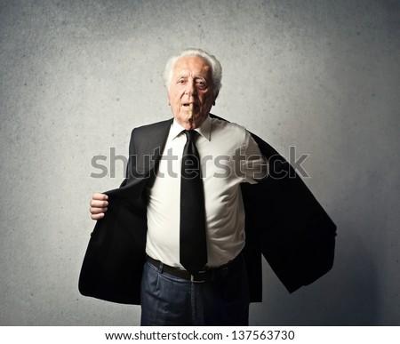 senior businessman undresses - stock photo