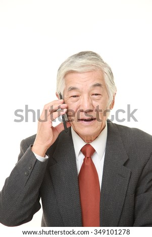 senior businessman with a smart phone   - stock photo