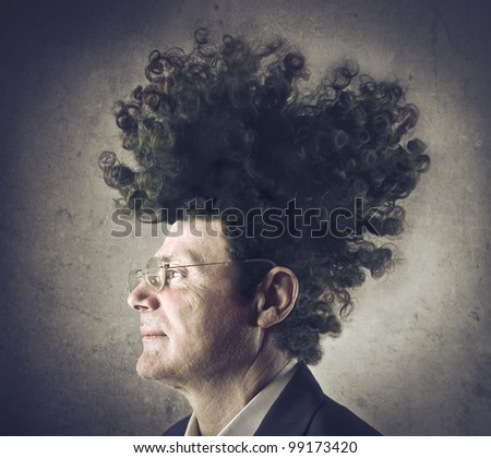 Senior businessman with bizarre upright hairstyle - stock photo