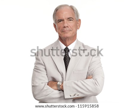 Senior businessman with his arms crossed - stock photo