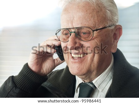 Senior businessman with phone  portrait