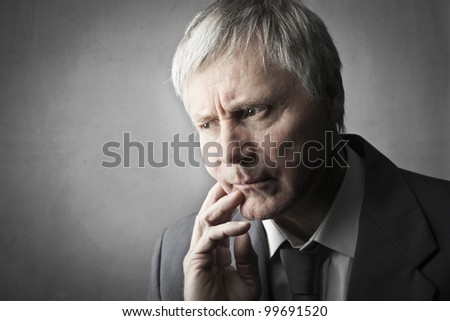 Senior businessman with worried expression - stock photo