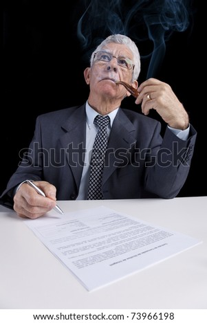 Senior businessman working at his office - stock photo