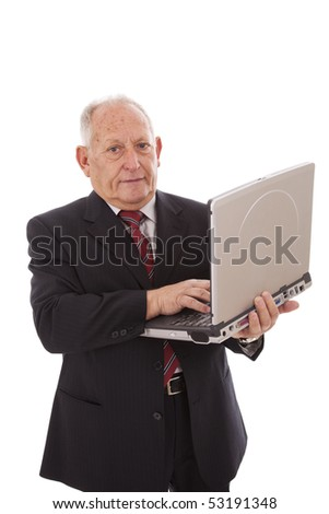 senior businessman working with a laptop (isolated on white) - stock photo