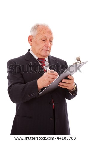 senior businessman writing in some paper clipboard (isolated on white) - stock photo