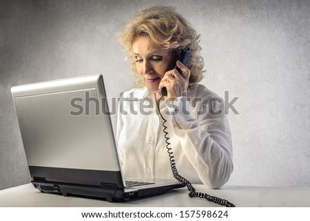 senior businesswoman working on the computer