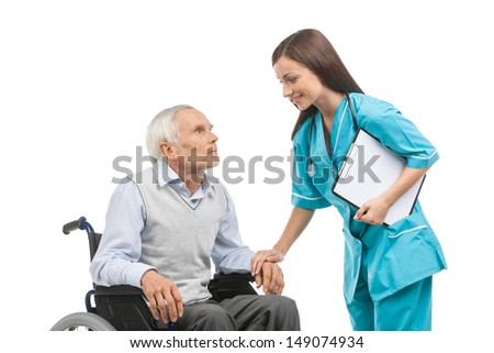 Senior care. Confident young nurse holding senior man hand and smiling while isolated on white - stock photo