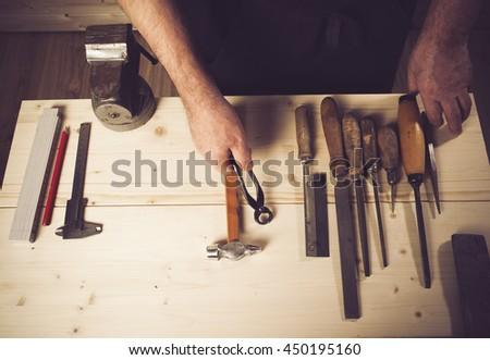 Senior carpenter working in his workshop - stock photo