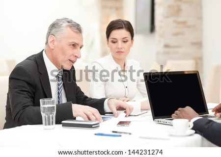 Senior CEO having staff meeting in restaurant - stock photo