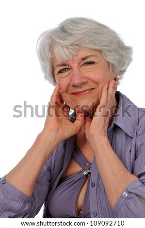 Senior Citizen Lady smiling isolated on a white background