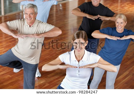 Senior citizens doing dance training in fitness center
