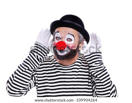 Senior clown in bowler hat  making the listening gesture - stock photo