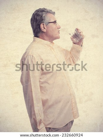 senior cool man drinking water - stock photo