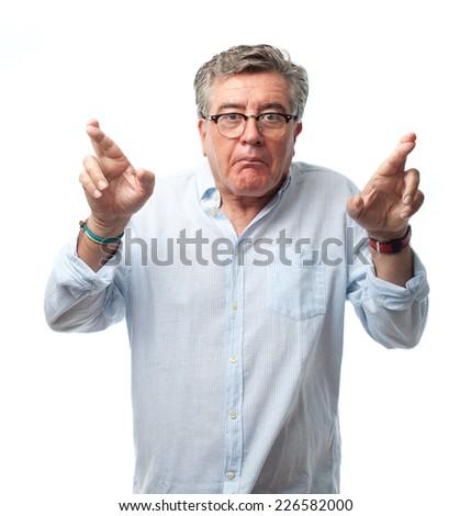 senior cool man finger crossing - stock photo