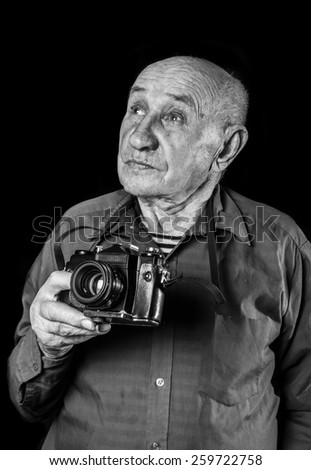 senior cool man with a camera - stock photo