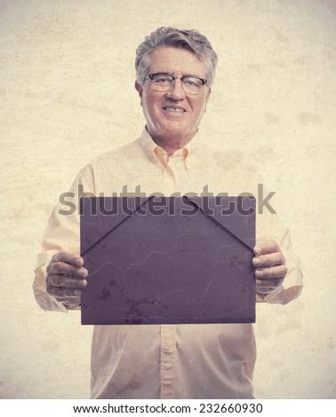 senior cool man with a folder - stock photo
