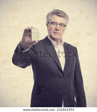 senior cool man with a gift - stock photo