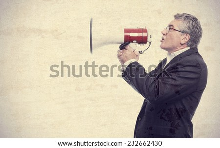 senior cool man with a megaphone - stock photo