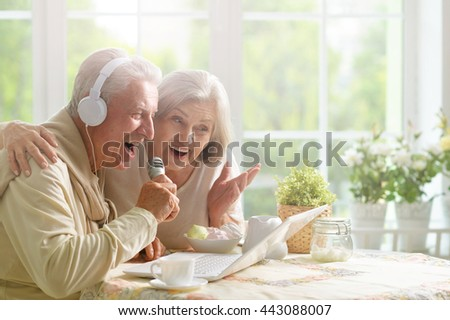 Senior couple  and microphone and laptop
