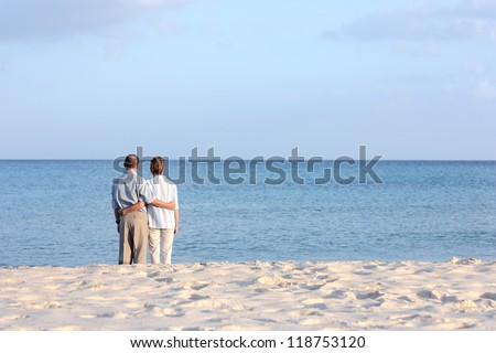 Senior couple at the beach - stock photo