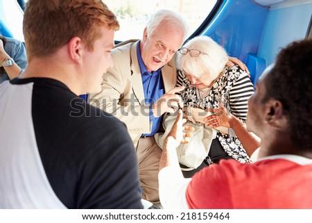 Senior Couple Being Harassed On Bus Journey - stock photo