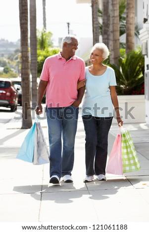 Senior Couple Carrying Shopping Bags - stock photo