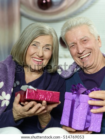 Senior couple celibrating Christmas
