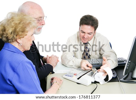 Senior couple consulting an accountant to help with taxes and financial planning.  White background