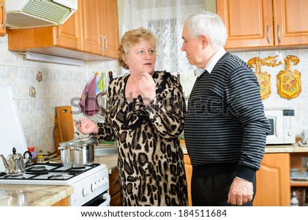 Senior couple cooking together - stock photo