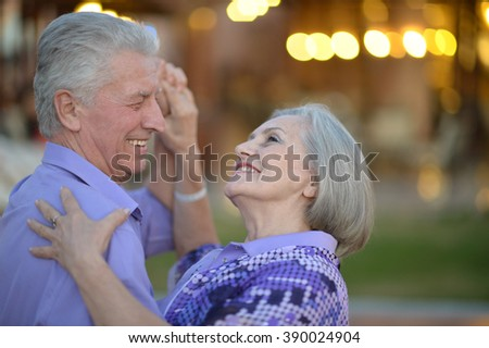 Senior couple dancing at evening - stock photo