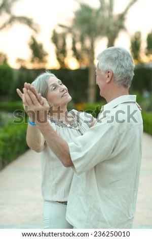 Senior couple dancing on the resort during vacation