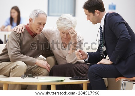 Senior Couple Discussing Test Results With Doctor - stock photo