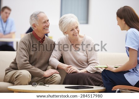 Senior Couple Discussing Test Results With Nurse
