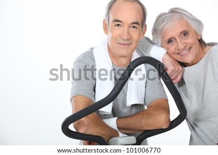 senior couple doing exercises in the gym - stock photo