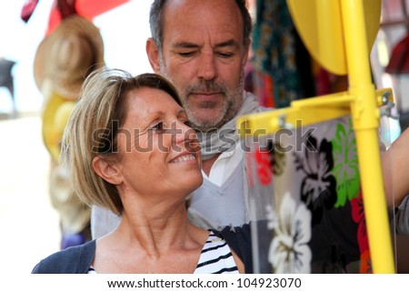 Senior couple doing shopping in souvenir shop