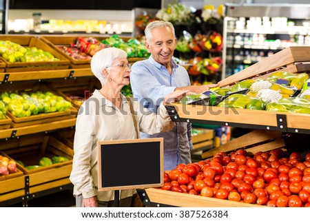 Senior couple doing some shopping together in supermarket
