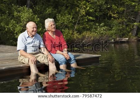 Senior couple enjoying a day at the lake - stock photo