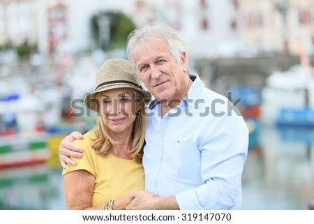 Senior couple enjoying journey in tourist city - stock photo