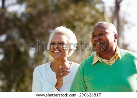 Senior Couple Enjoying Walk Together