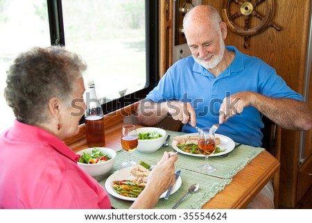 Senior couple enjoys a healthy meal in the kitchen of their RV.