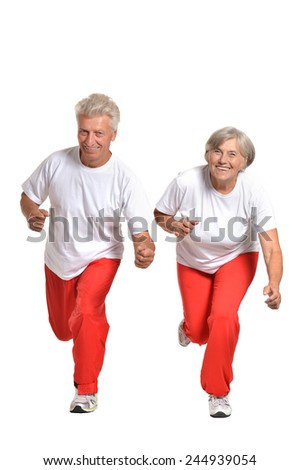 Senior couple exercising on a white background - stock photo