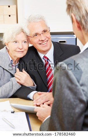 Senior couple getting legal advice from lawyer in office - stock photo
