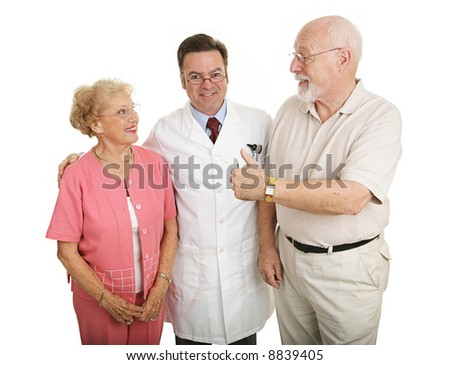 Senior couple giving a thumbs-up to their eye doctor after a successful office visit.  Isolated on white. - stock photo