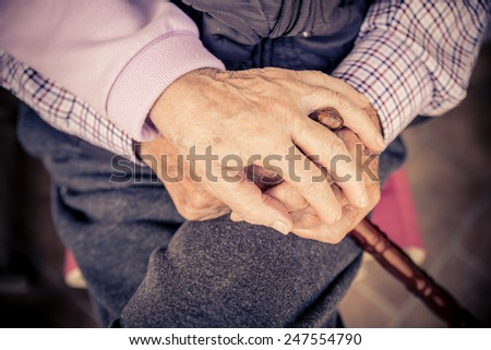 Senior couple hands - Aged woman holding her husband hands - Concepts about oldness,consolation and lifestyle - stock photo