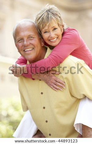 Senior Couple Having Fun In City - stock photo